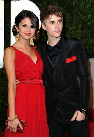 Singer/actress Selena Gomez and singer Justin Bieber arrive at the Vanity Fair Oscar party hosted by Graydon Carter held at Sunset Tower in West Hollywood, California. Photo: Getty Images