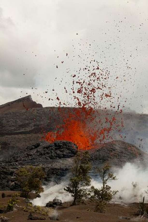 In this photo taken Sunday and provided by the U.S.Geological Survey, a vent, around which a low cone was forming, is seen near the Hawaii volcano. Scientists are monitoring a new vent that has opened at the Kilauea volcano, sending lava shooting up to 65 feet high. (AP Photo/US Geological Survey) Photo: Associated Press