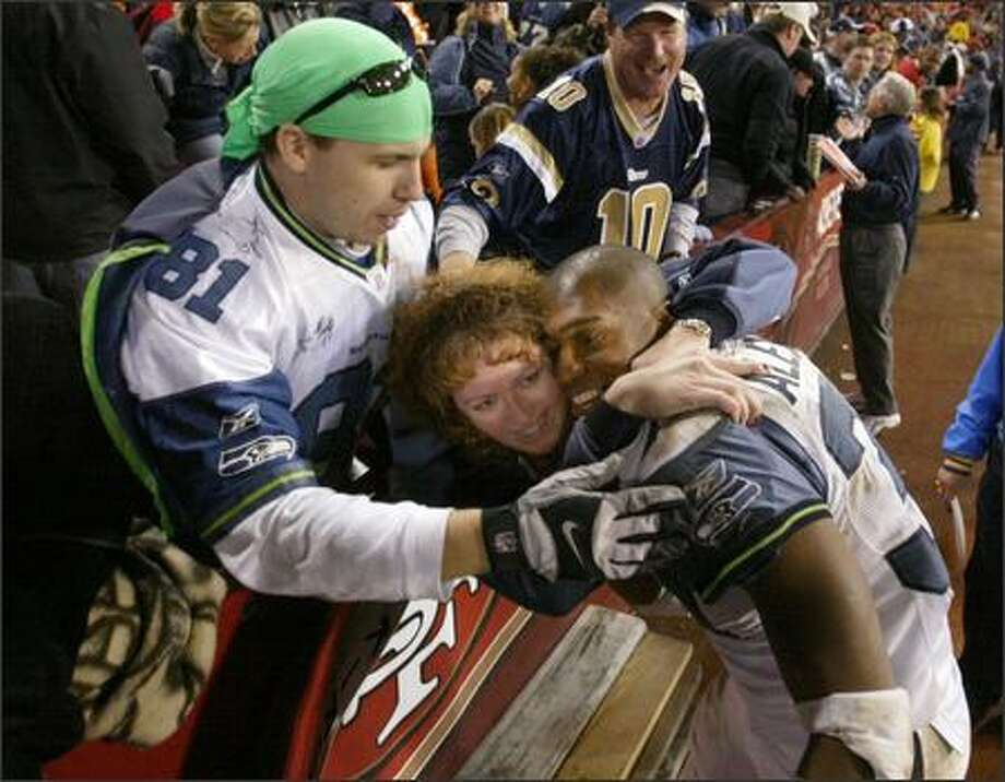 Seattle running back Shawn Alexander has fans in San Francisco as well. He got an impromtu hug as he exited the field following the Seahawks' 24-17 victory over the 49ers. Photo: Scott Eklund, Seattle Post-Intelligencer