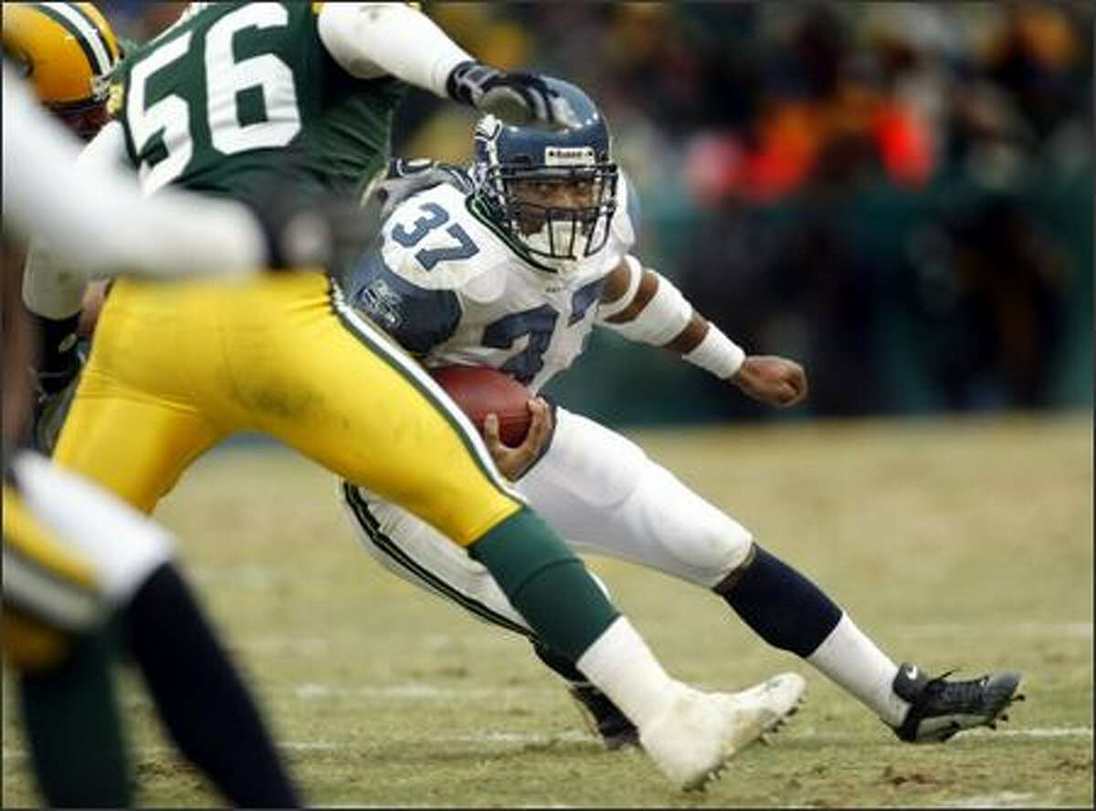 Seahawks running back Shaun Alexander (37) did score three touchdowns but found running room scarce as he rushed for only 45 yards on 20 carries.