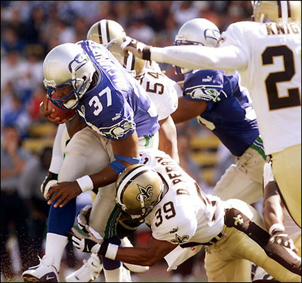 Seattle's Shaun Alexander plows through New Orleans tacklers for a short gain in the second quarter.
