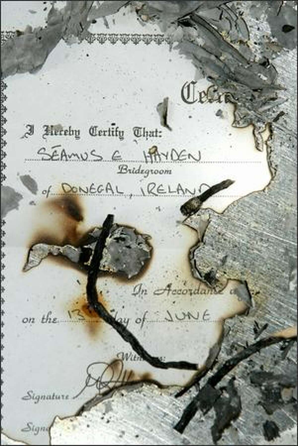 The scorched remains of a copy of Amanda Schultz's wedding certificate is evidence of her passing through the Anger stage of her marriage wake.