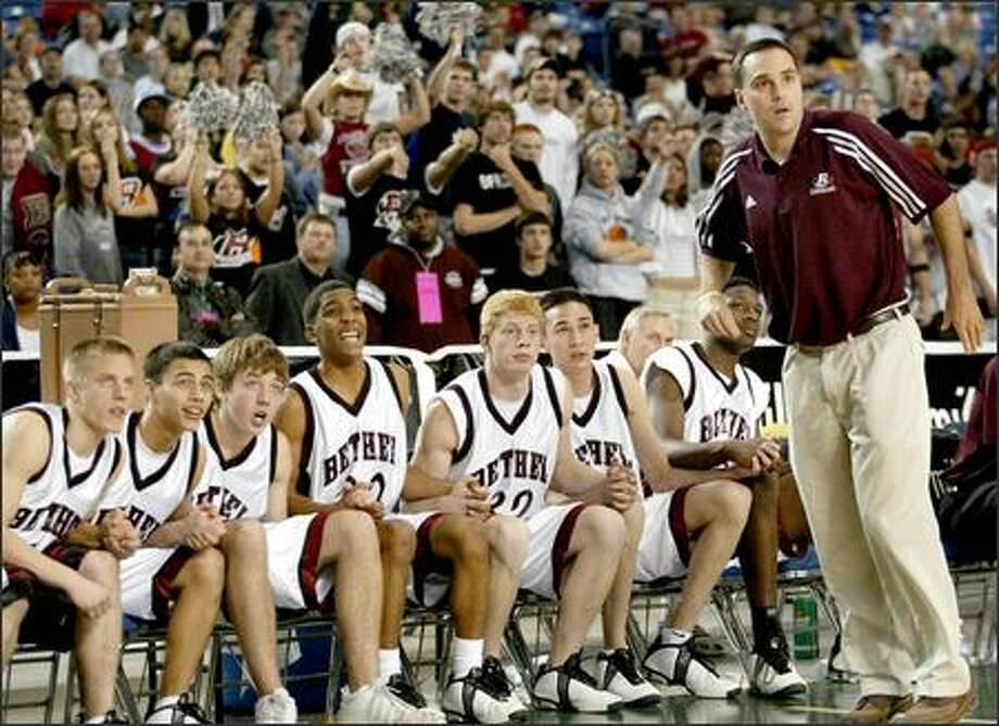 Bethel coach Pat Mullen and his players watch an overtime free throw against Puyallup. The Braves shot 9-for-12 from the line in the extra period. Photo: Scott Eklund, Seattle Post-Intelligencer