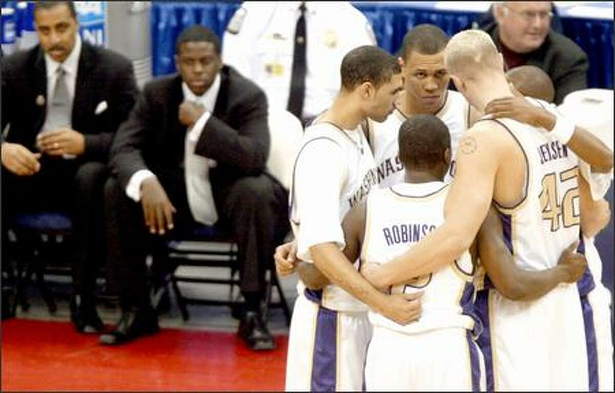 University of Washington players huddle before their game against UAB.