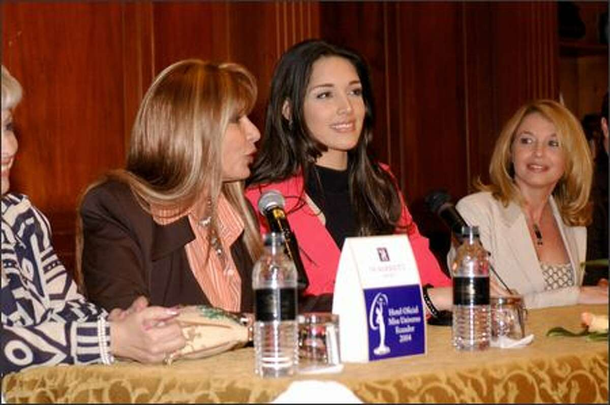 The JW Marriott hotel of Quito, Ecuador hosted a press confrence to celebrate the arrival of Amelia Vega, Miss Universe 2003. From left, Ivonne Baki, Minister of Ecuador, Amelia Vega, Miss Universe 2003, and Paula M. Shugart, President of the Miss Universe Organization.