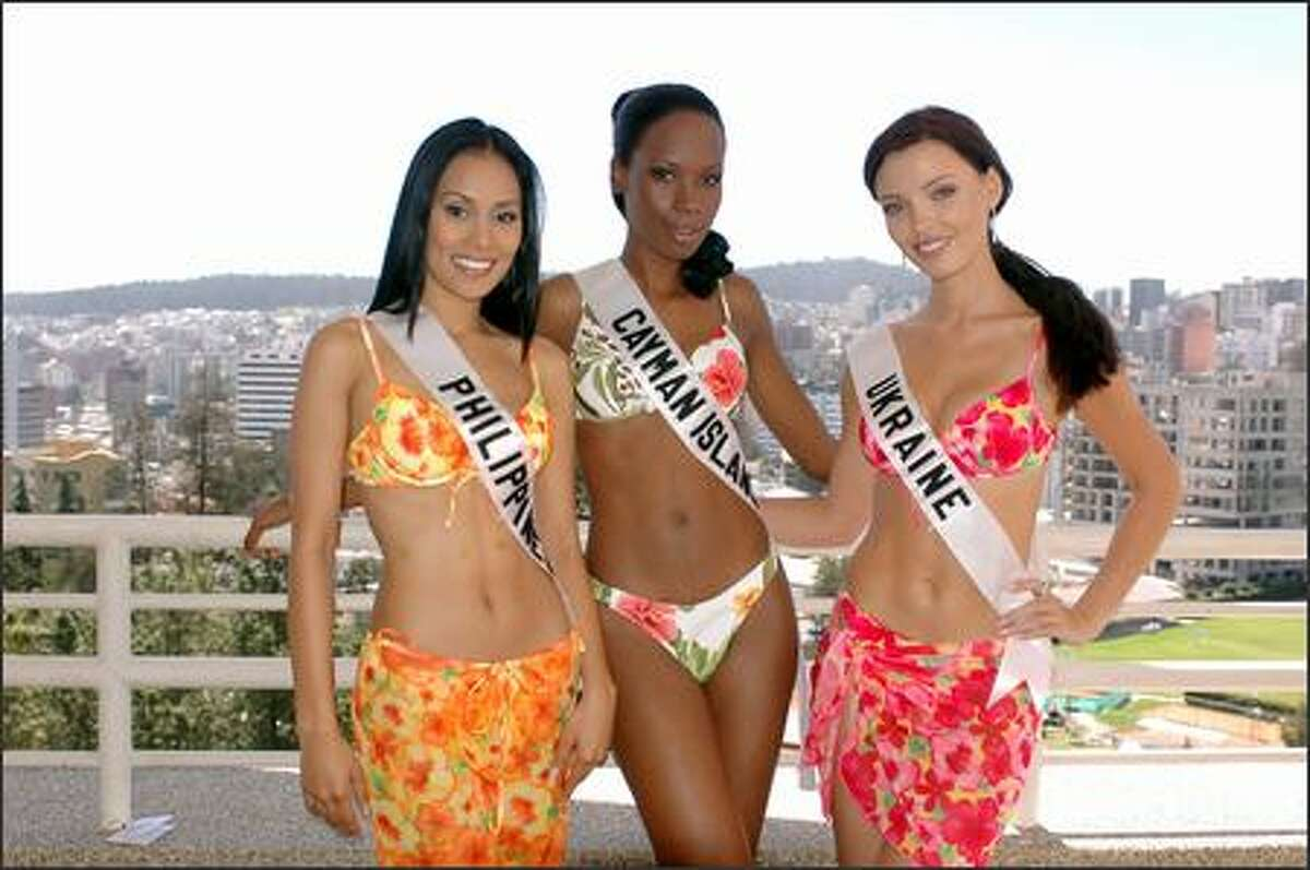 From left, Maricar Balagtas, Miss Philippines; Stacey-Ann Kelly, Miss Cayman Islands; and Oleksandra Nikolayenko, Miss Ukraine, pose during registration and fittings for the 2004 Miss Universe competition at the JW Marriott Hotel in Quito, Ecuador. They will compete for the title of Miss Universe 2004 during the live (delayed PT) NBC broadcast of the 53rd annual Miss Universe competition from Quito on June 1.