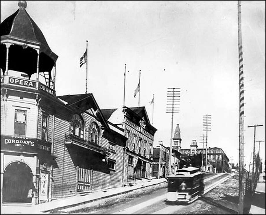 """Cordray's Theater: A streetcar speeds past Cordray's Theater at Third Avenue and Madison Street, circa 1892. The theater was the idea of John Cordray who is credited with bringing """"polite vaudeville"""" to Seattle from 1890 to 1896. The theater was razed in 1907. Photo: Seattle Post-Intelligencer"""