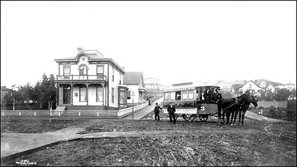 A streetcar came for hire, 1884: Seattle's first streetcar sits at the intersection of Pike Street