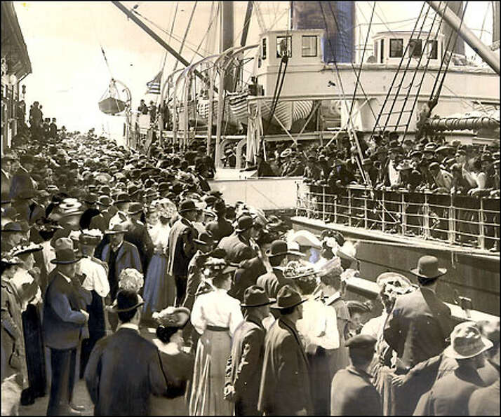 Off to the gold rush, circa 1898: Thousands crowd the Seattle waterfront to wish good luck to fortun