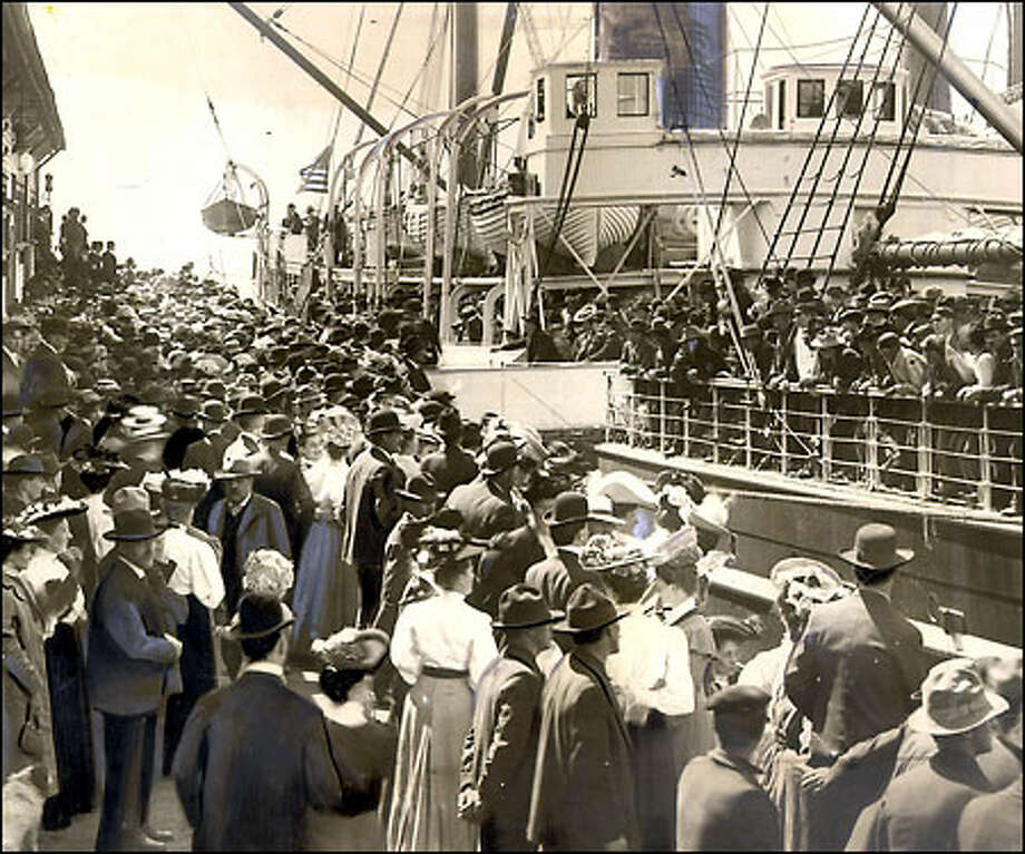 Off to the gold rush, circa 1898: Thousands crowd the Seattle waterfront to wish good luck to fortune seekers heading the Klondike Gold Rush, which broke out in 1897. Some of the city's biggest fortunes were made by merchants who stayed behind to outfit dreamers. Photo: Seattle Post-Intelligencer