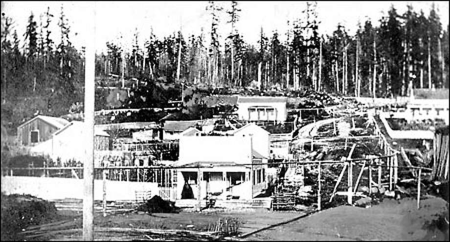 Seattle, 1860: This is believed to be the first photo taken of Seattle, at a time when 300 settlers lived here. Looking up the hill from First Avenue, James Street is on the right and Cherry is the next street to the left. Beyond Third Avenue is the thick forest that stood on the hill behind the city. Lumberman Henry Yesler's home is in the foreground. Photo: Seattle Post-Intelligencer
