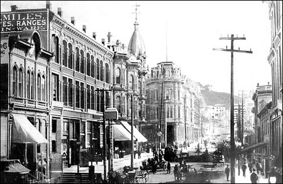 The view from Post Street, circa 1889: The heart of Seattle's business district sat astride Yesler