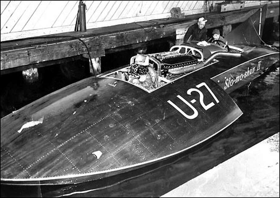 A speedy success, 1950: The success of the hydroplane Slo-mo-shun IV, piloted by the legendary Stan Sayres, shown here looking on as Anchor Jensen sits at the controls, brought a new craze to Seattle – hydro racing. Photo: Seattle Post-Intelligencer