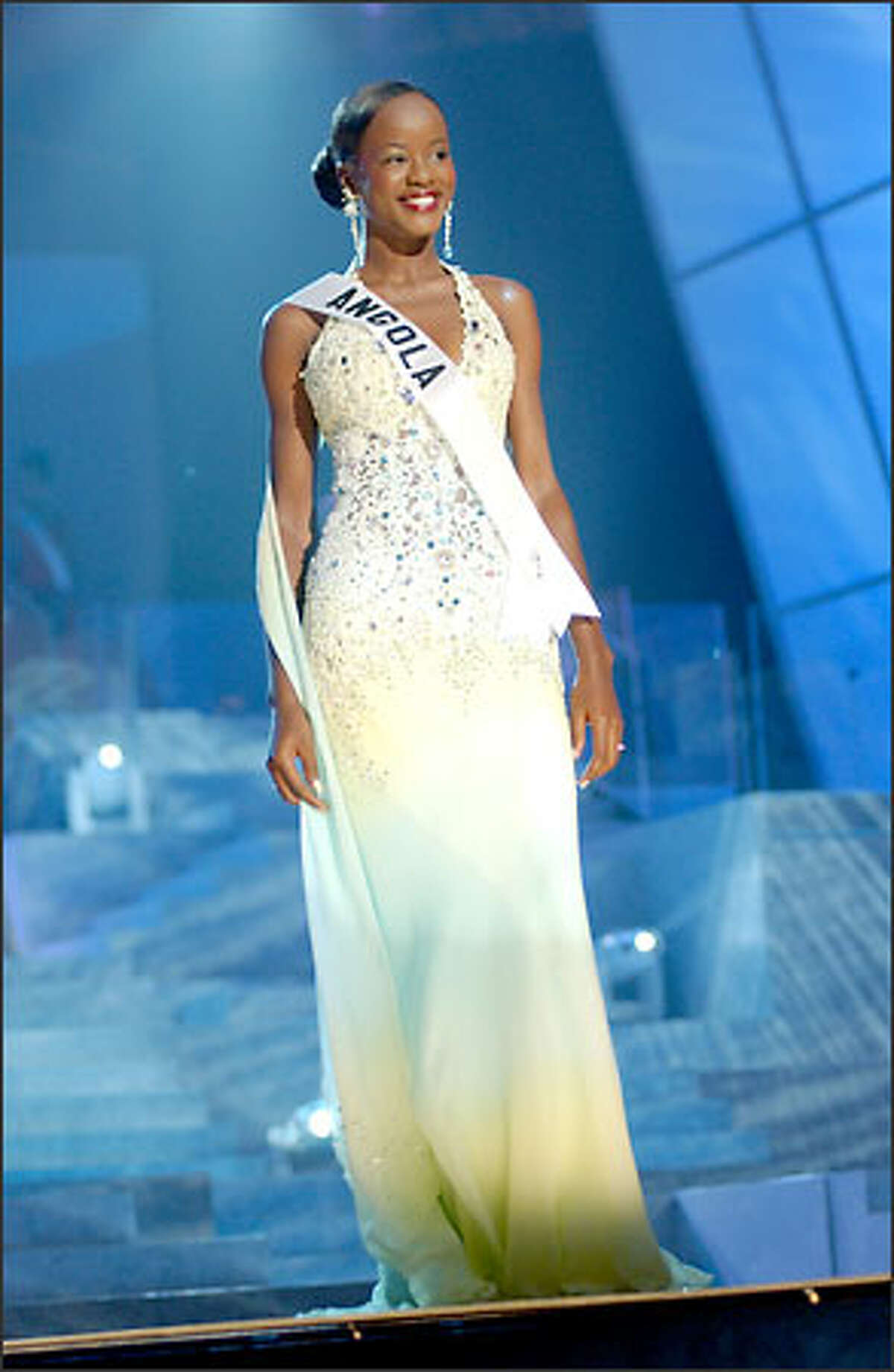 Telma de Jesus Esperanca Sonhi, Miss Angola, competes in an evening gown of her choice during the 2004 Miss Universe Presentation Show at CEMEXPO in Quito, Ecuador on May 27. Each delegate was judged by a preliminary panel of distinguished judges in three categories consisting of individual interviews, swimsuit competition and evening gown competition. The scores will be tallied and the top 15 delegates will be announced during the NBC broadcast of the 53rd annual Miss Universe competition from Quito on June 1 at 9 p.m. (delayed PT).
