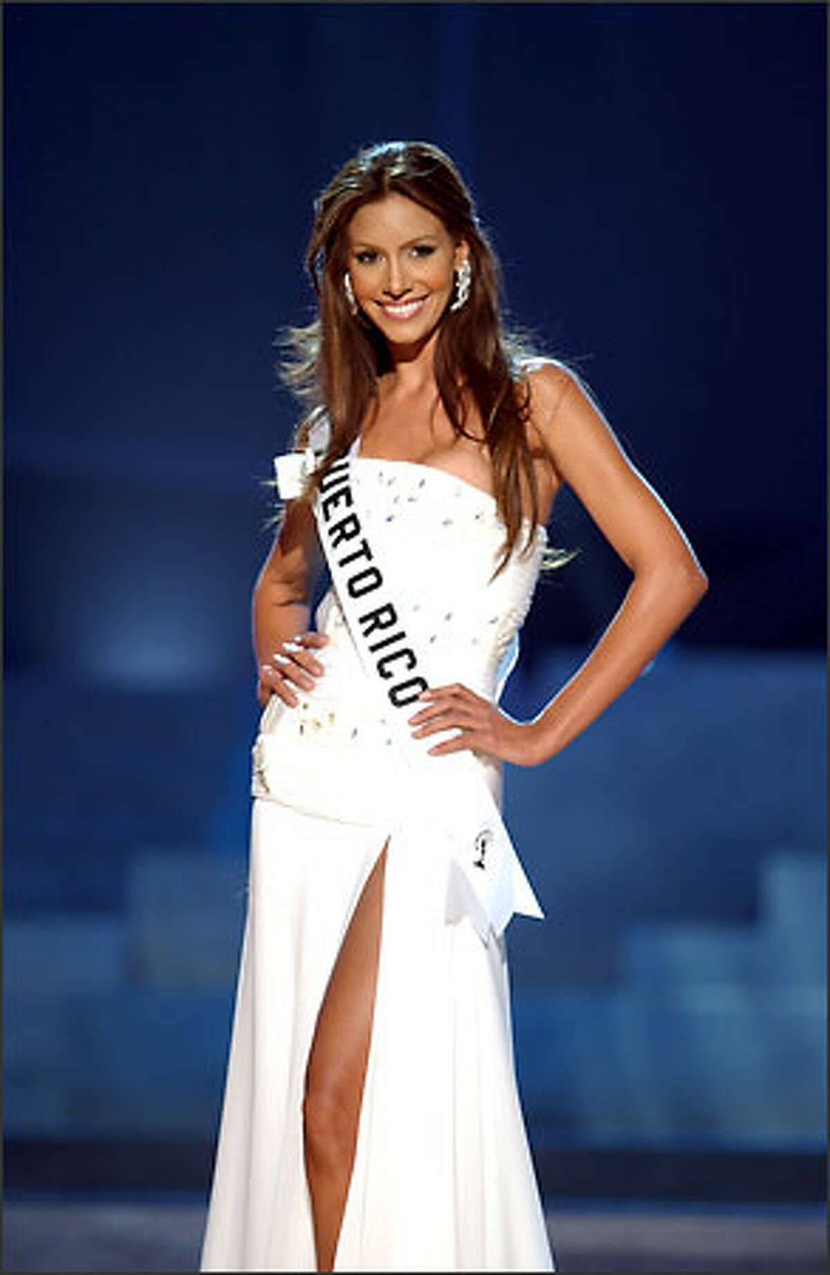Alba Giselle Reyes Santos, Miss Puerto Rico, competes in an evening gown of her choice during the 2004 Miss Universe Presentation Show at CEMEXPO in Quito, Ecuador on May 27. Each delegate is judged by a preliminary panel of distinguished judges in three categories consisting of individual interviews, swimsuit competition and evening gown competition. The scores will be tallied and the top 15 delegates will be announced during the NBC broadcast of the 53rd annual Miss Universe competition from Quito on June 1 at 9 p.m. (/delayed PT).