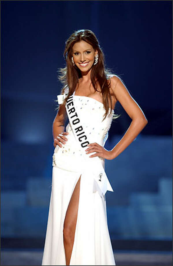 Alba Giselle Reyes Santos, Miss Puerto Rico, competes in an evening gown of her choice during the 2004 Miss Universe Presentation Show  at CEMEXPO in Quito, Ecuador on May 27. Each delegate is judged by a preliminary panel of distinguished judges in three categories consisting of individual interviews, swimsuit competition and evening gown competition.  The scores will be tallied and the top 15 delegates will be announced during the NBC broadcast of the 53rd annual Miss Universe competition from Quito on June 1 at 9 p.m. (/delayed PT). Photo: Miss Universe L.P., LLLP