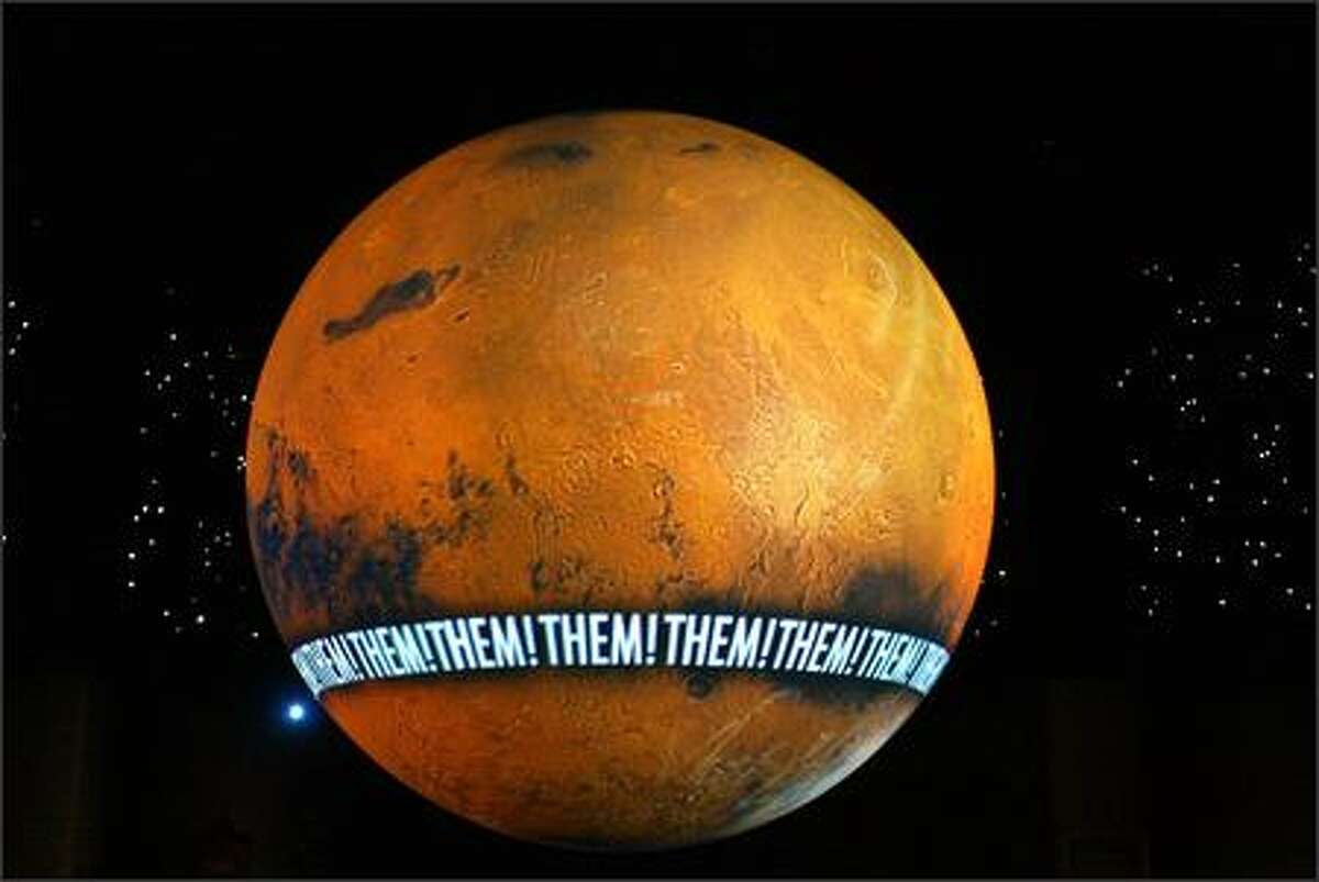 The Homeworld Globe becomes a fascimile of Mars while trumpeting the museum's