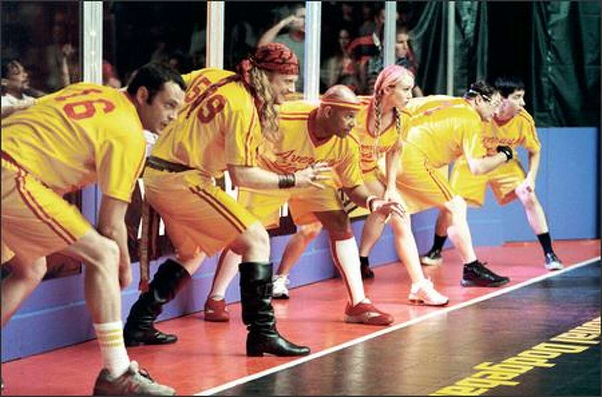 From left, Vince Vaughn, Alan Tudyk, Chris Williams, Christine Taylor, Stephen Root and Justin Long line-up for the start of the ultimate dodgeball competition.