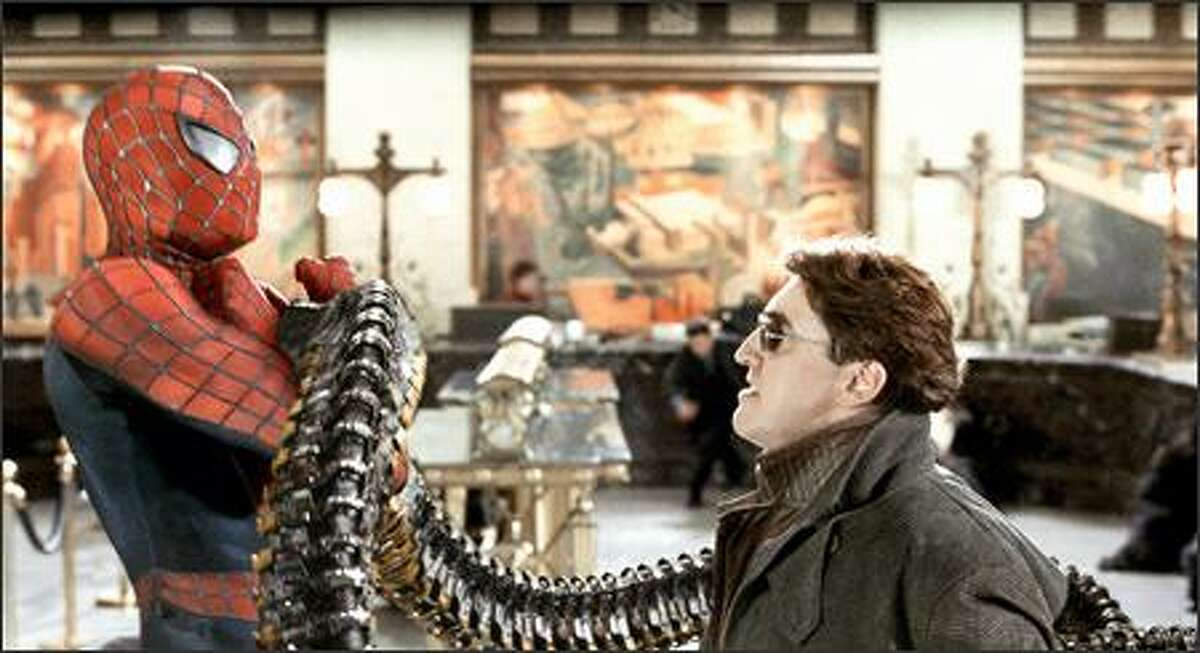 Spider-Man (Tobey Maguire) squares off against Dr. Otto Octavius, aka