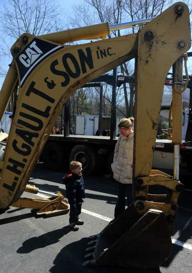 Jacqueline Calabro and her three-year-old son Patrick check out the excavator during Touch-a-Truck Saturday, Mar. 26, 2011 at Coleytown Elementary School in Westport, Conn. Photo: Autumn Driscoll / Connecticut Post