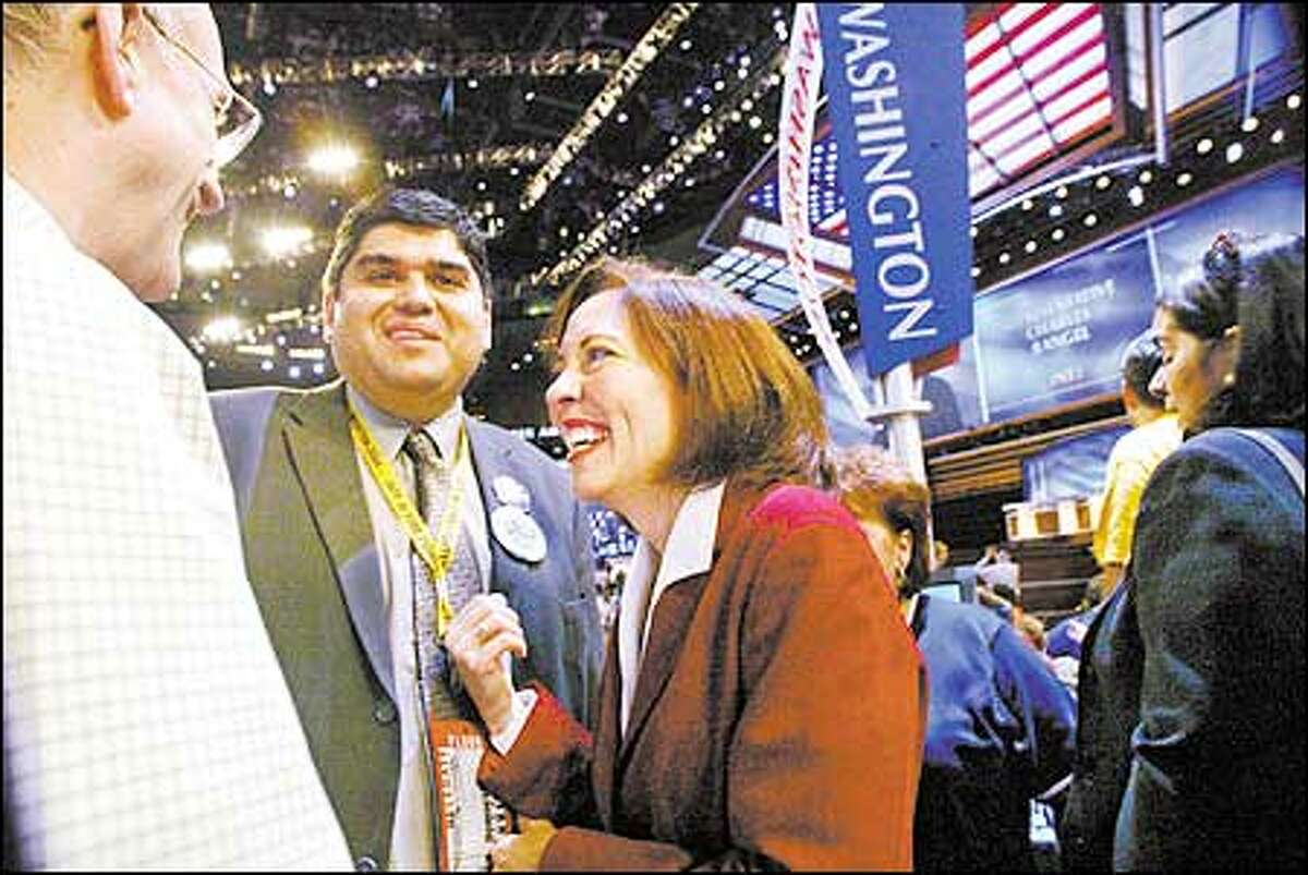 Sen. Maria Cantwell talks with Washington state delegates Javier Valdez, center, and David McDonald at the Democratic National Convention in Boston. On Wednesday night the nation's delegates formally nominated Sen. John Kerry as the Democratic candidate for president.