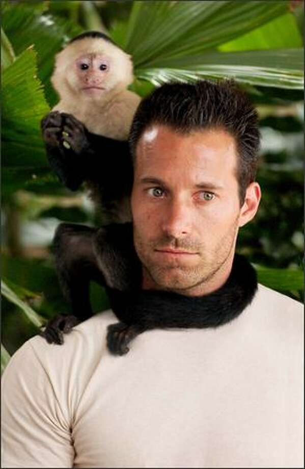 Johnny Messner plays Capt. Bill Johnson, a rugged loner who lives in the jungle on his boat. For a hefty fee, he agrees to take the scientists downriver even though the situation is fraught with peril. The only one he cares about is his pet monkey, Kong. Photo: Sony Pictures
