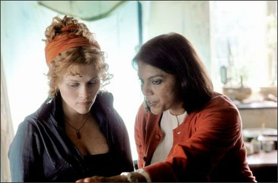 "Reese Witherspoon and Mira Nair on the set of ""Vanity Fair,"" a Focus Features release. The film is rated PG-13 for some sensuality (partial nudity) and for a brief, violent image. The film runs two hours and 21 minutes. Nair, a native of India, has directed ""Salaam Bombay!"" ""Mississippi Masala"" and ""Monsoon Wedding."" Photo: Focus Features"