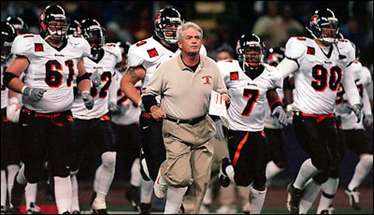 OSU coach Dennis Erickson leads his Beavers onto the field of battle.