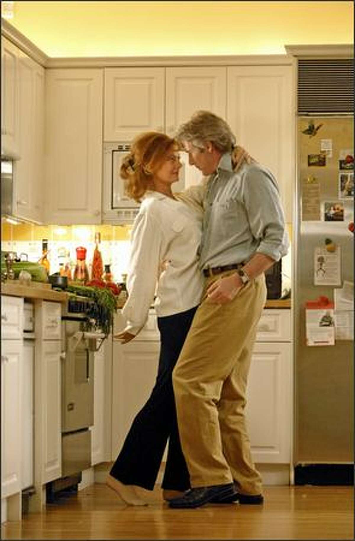 John Clark (Richard Gere) puts the moves on his wife, Beverly (Susan Sarandon).