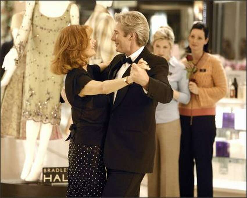 Reinvigorated by his experiences with competitive ballroom dancing, John (Richard Gere) becomes an entirely new man in the eyes of wife Beverly (Susan Sarandon).