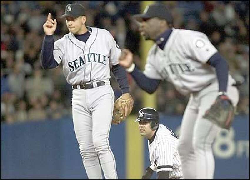 Alex Rodriguez signals after turning a double play on the Yankees' Luis Sojo in the third inning.