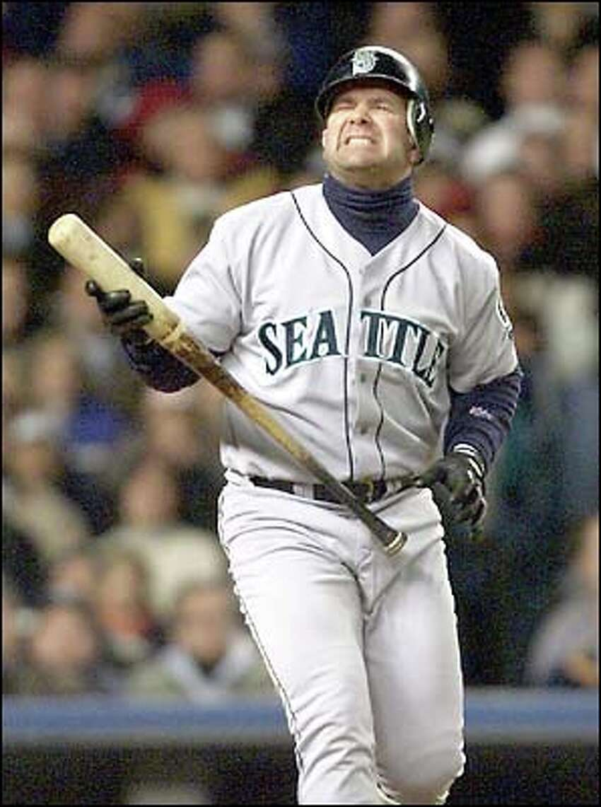 Edgar Martinez isn't happy with a pitch.