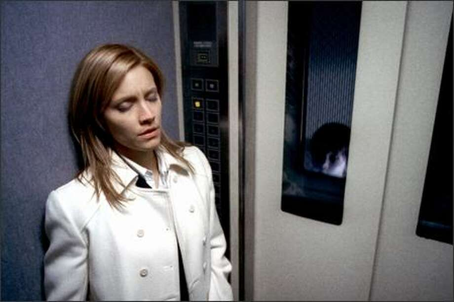 "KaDee Strickland (left) and Yuya Ozeki in a scene from ""The Grudge,"" based on the Japanese blockbuster ""Ju-On: The Grudge."" The normal façade of a modest house in Tokyo belies the hidden terror within. It is possessed by a violent plague that destroys the lives of everyone who enters. Photo: Sony Pictures"