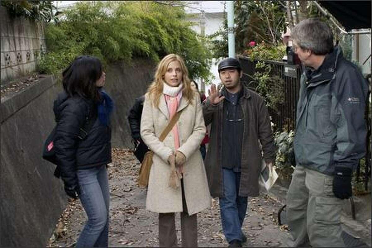 Sarah Michelle Gellar, center, and director Takashi Shimizu on the set. Shimizu wrote and directed the original Japanese film.
