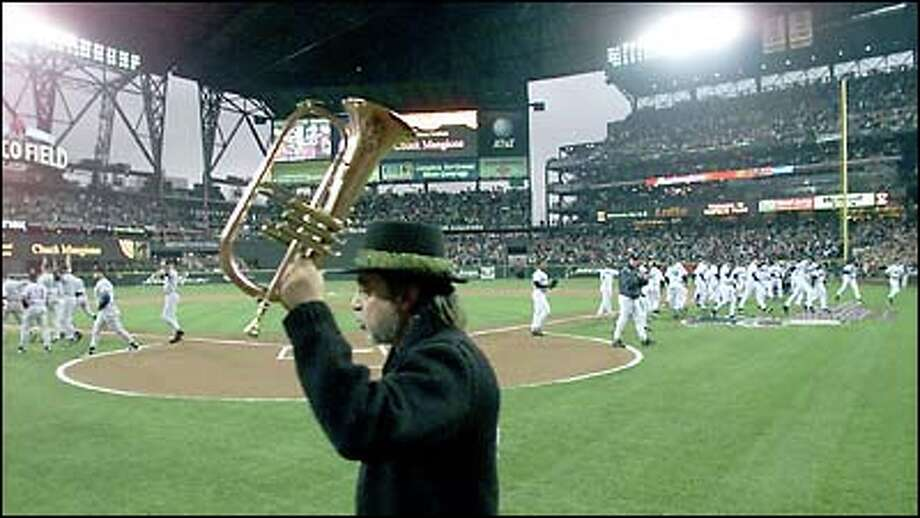 Chuck Mangione played the national anthem for Game 3. Photo: Dan DeLong, Seattle Post-Intelligencer