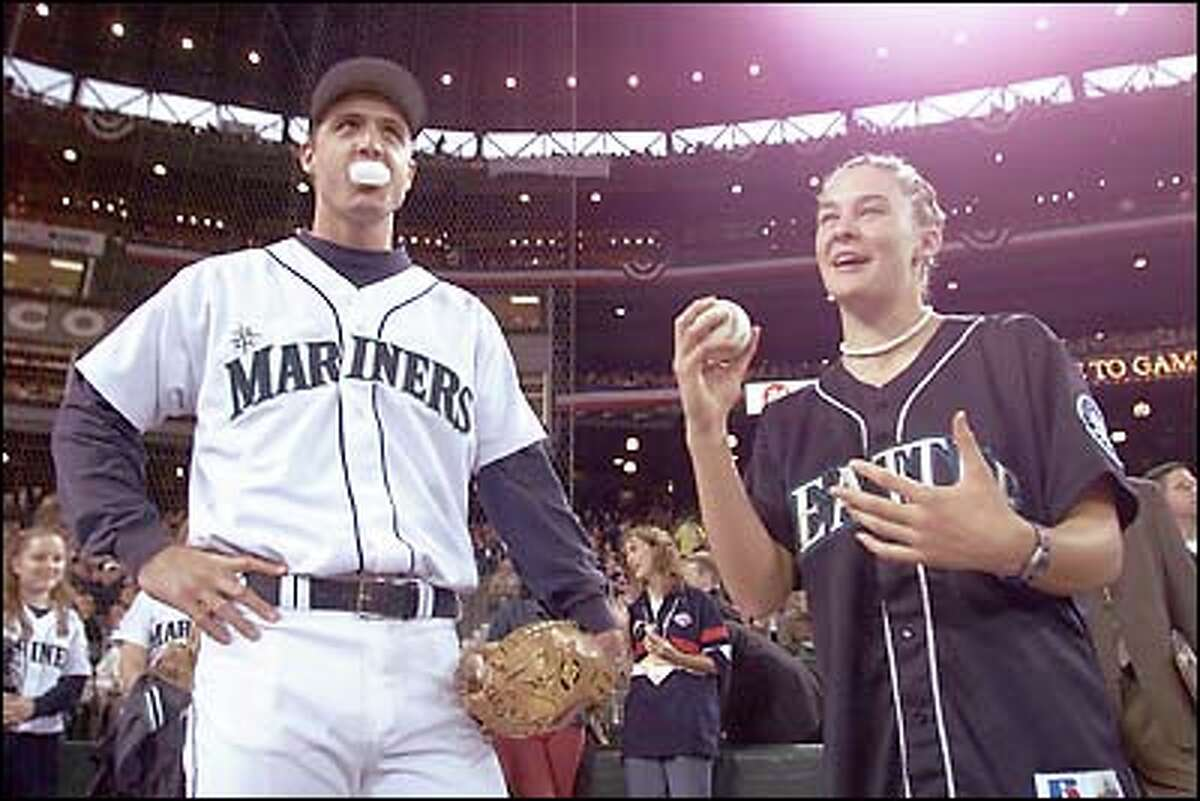 Olympic Gold Medalist Megan Quann hangs out with M's catcher Dan Wilson before the game. She threw out the ceremonial first pitch.