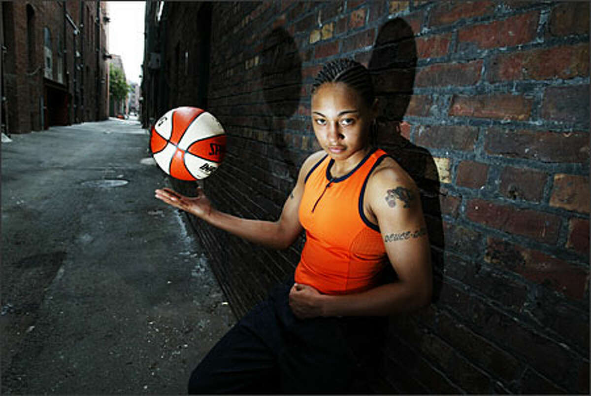 Seattle Storm guard Betty Lennox Eklund: A portrait of fiesty Seattle Storm guard Betty Lennox for a feature early in the season. The story talks about her tough upbringing and how she brought a needed attitude to the Storm. She proved her worth as one of the more valuable members of the team, winning MVP of the finals. She was terrific to deal with and was very enthusiastic and appreciative about being photographed.