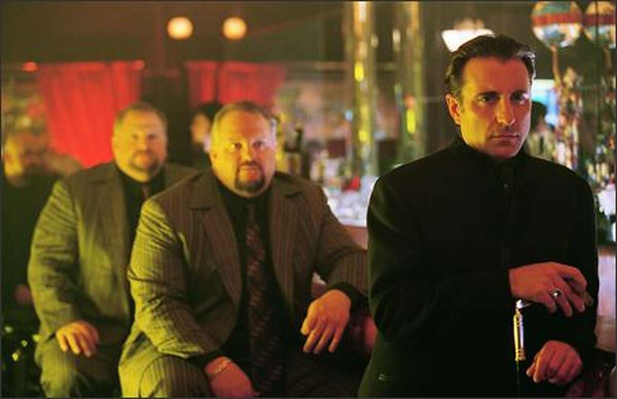 Ruthless entrepreneur Terry Benedict (Andy Garcia) would love nothing more than exacting revenge on the brash crew who robbed $160 million from his casinos -- especially their ringleader, Danny Ocean (George Clooney), who stole Benedict's girlfriend in the process. The power twins David and Larry Sontag are in the background.