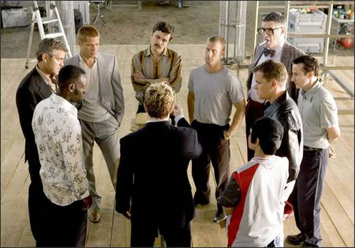 """After splitting the $160 million take from """"Ocean's Eleven,"""" each of the Ocean's crew have tried to go straight, lay low and live a legit life. But when someone breaks Rule Number One and rats them out to entrepreneur Terry Benedict (Andy Garcia), going straight is no longer an option. This scene shows Don Cheadle, George Clooney, Brad Pitt, Casey Affleck, Scott Caan, Elliott Gould, Eddie Jemison, Matt Damon, Shaobo Qin and Eddie Izzard."""
