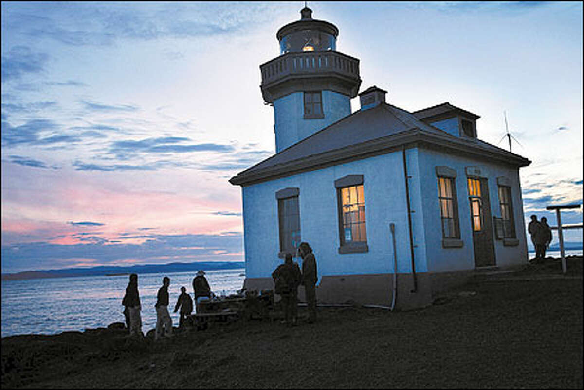 The Lime Kiln Lighthouse is a whale information center and a beacon for people who come to watch the orcas.