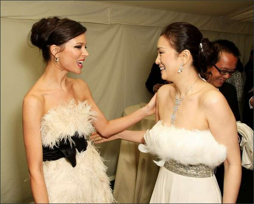 Designer Georgina Chapman (L) and actress Gong Li arrive at the Britain's Best 2008 awards at London Television Studios in London, England. The award ceremony honours outstanding Britons in categories including business, art, television, music, film, sport and fashion.