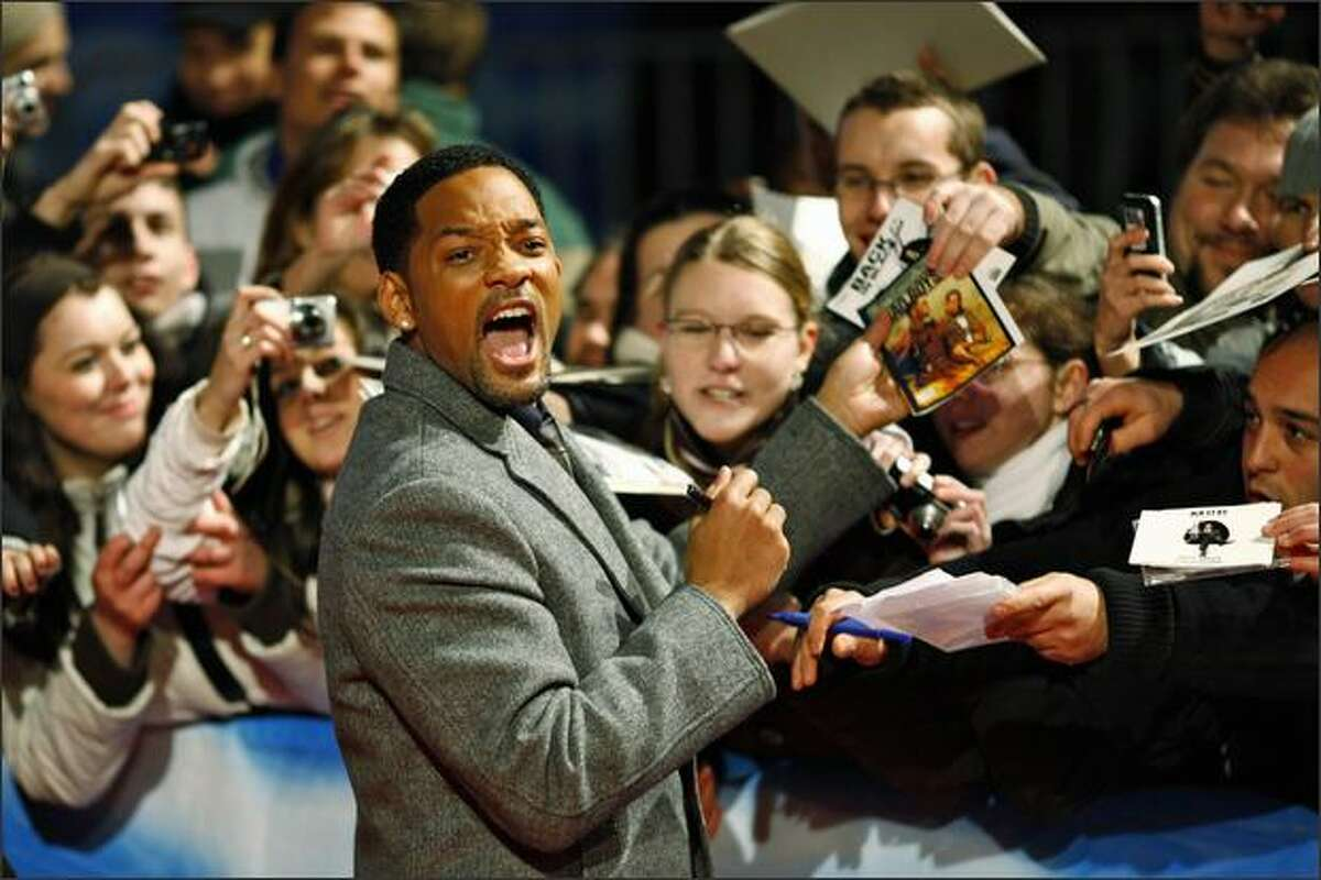 Actor Will Smith signs autographs for fans prior to the German premiere of his movie