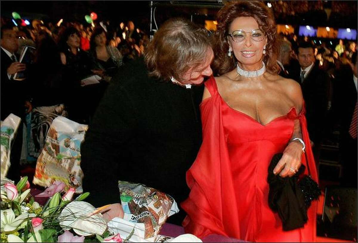 French actor Gerard Depardieu (left) and Italian screen legend Sophia Loren joke as they take part in the carnival at Santa Cruz de Tenerife on the Spanish Canary island of Tenerife, Jan. 30.