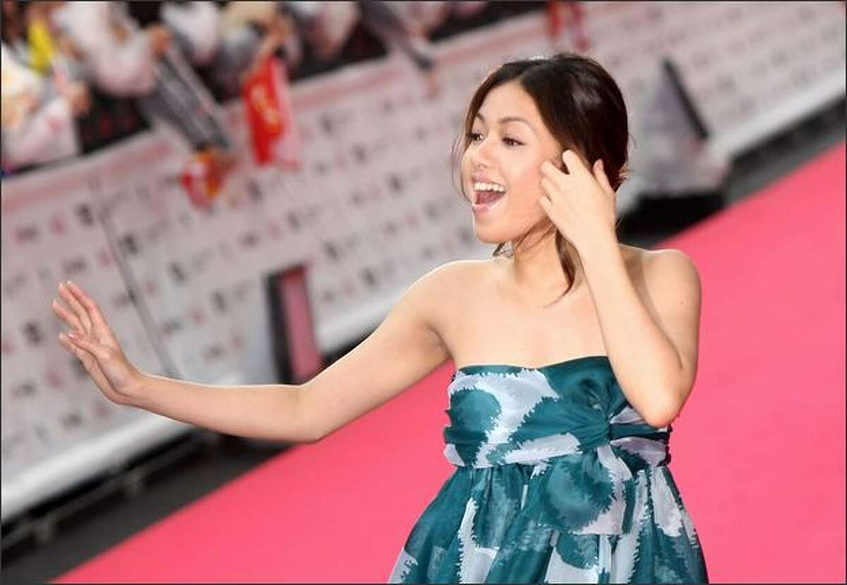 Singer Yuna Ito walks on the red carpet.