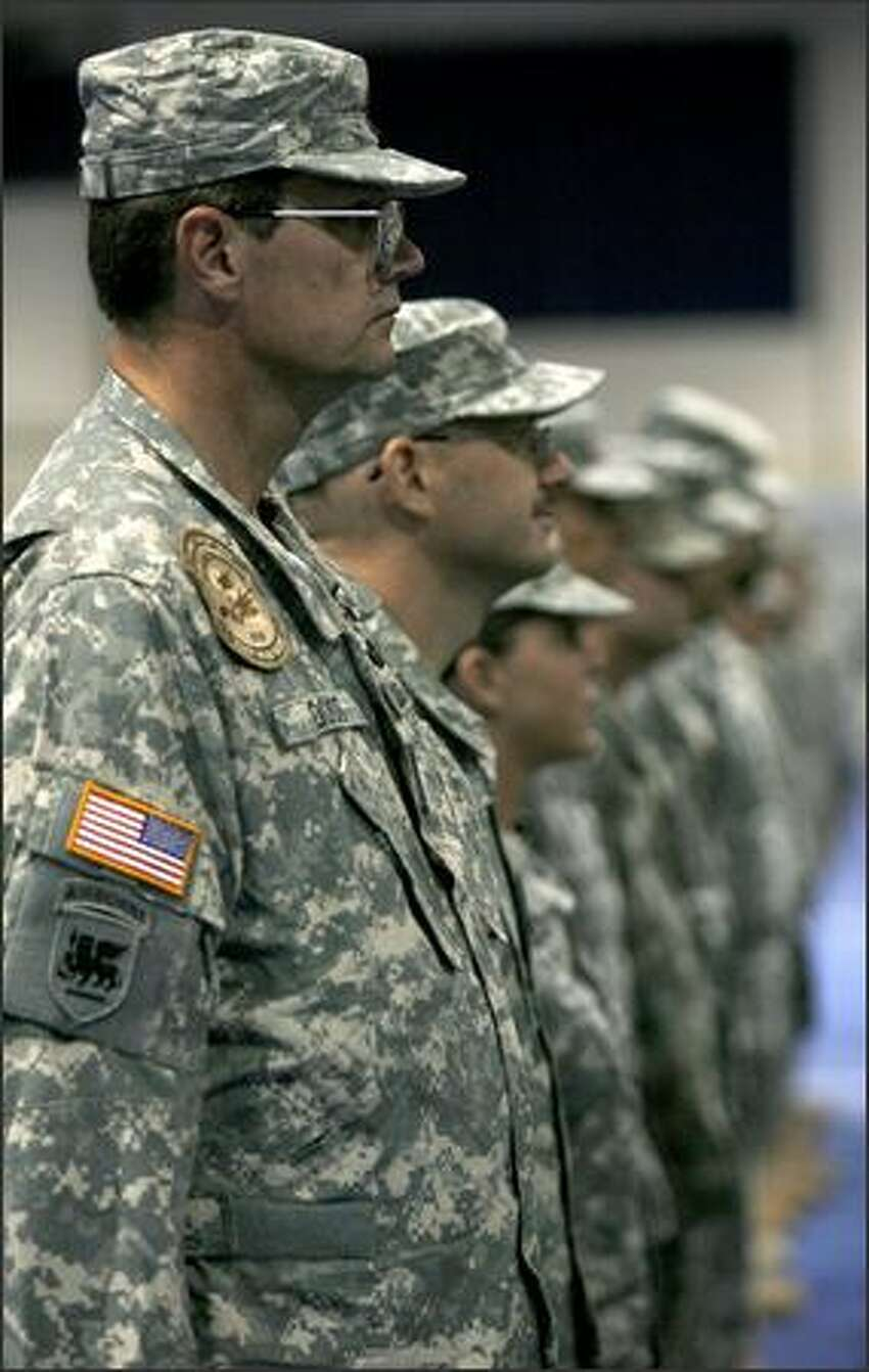 Soldiers from the 1/168 Aviation Battalion and the 4/2 brigade listen as a speaker welcomes them back from Iraq.