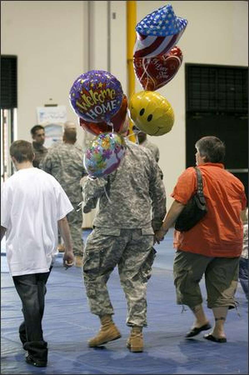 A soldier leaves Fort Lewis after being welcomed home from Iraq.