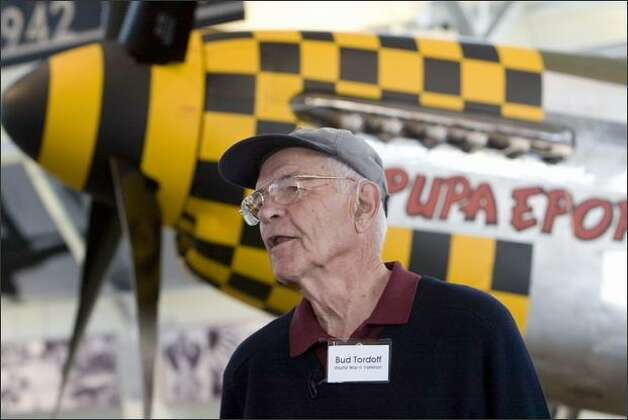 "Harrison ""Bud"" Tordoff, 85, flew the P-51 Mustang behind him when he was 22 in 1945 fighting the Germans. He logged more than 1,000 hours in combat. The plane displays the yellow and black checkerboard nose of the 353rd Fighter Group (bud's division). He was first reunited with his plane in the summer of 2003. Photo: Grant M. Haller, Seattle Post-Intelligencer"