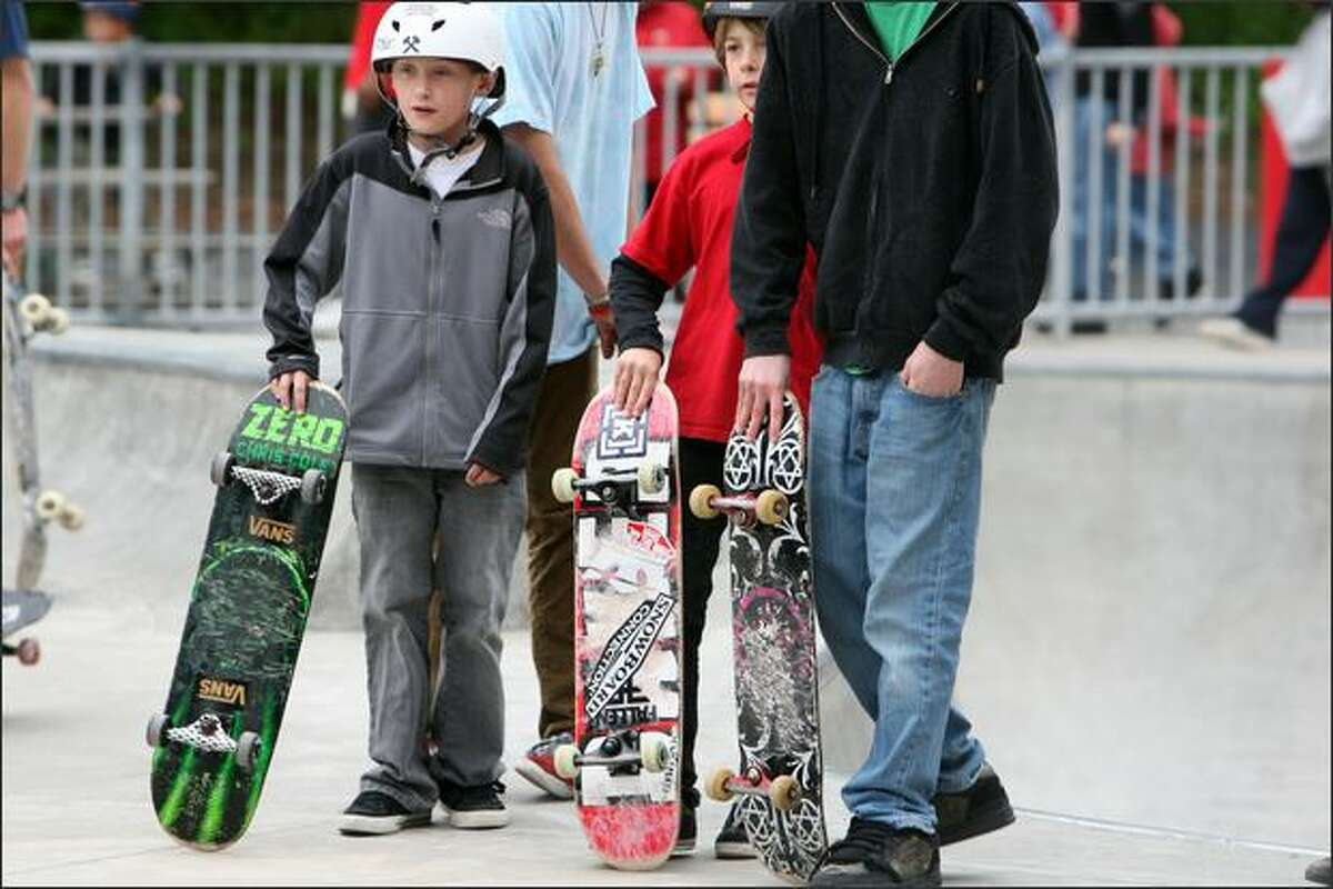 A few youths wait their turn at Lower Woodland Skateboard Park in Seattle on Saturday.