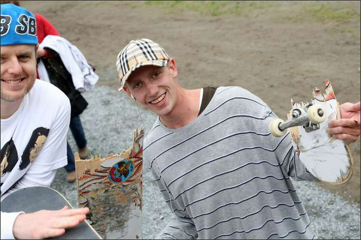 Peyton Dyer from Sammamish is still smiling after he snapped his skateboard in half during a contest during the opening of Lower Woodland Skateboard Park.