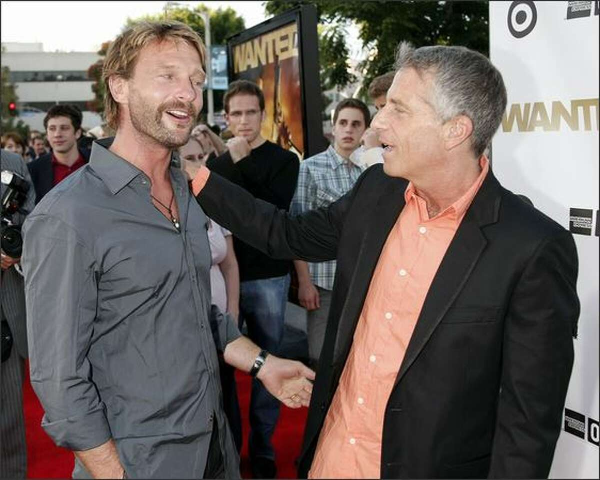 """Actor Thomas Kretschmann (L) and producer Marc Platt arrive at the opening of the Los Angeles Film Festival with the premiere of Universal's """"Wanted"""" at the Village Theater in Los Angeles, California."""